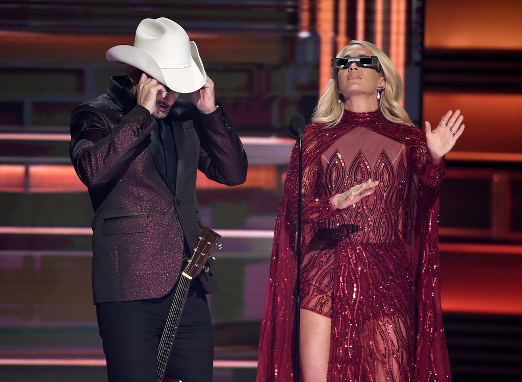 . Hosts Brad Paisley, left, and Carrie Underwood appear during the opening of the 51st annual CMA Awards at the Bridgestone Arena on Wednesday, Nov. 8, 2017, in Nashville, Tenn. (Photo by Chris Pizzello/Invision/AP)