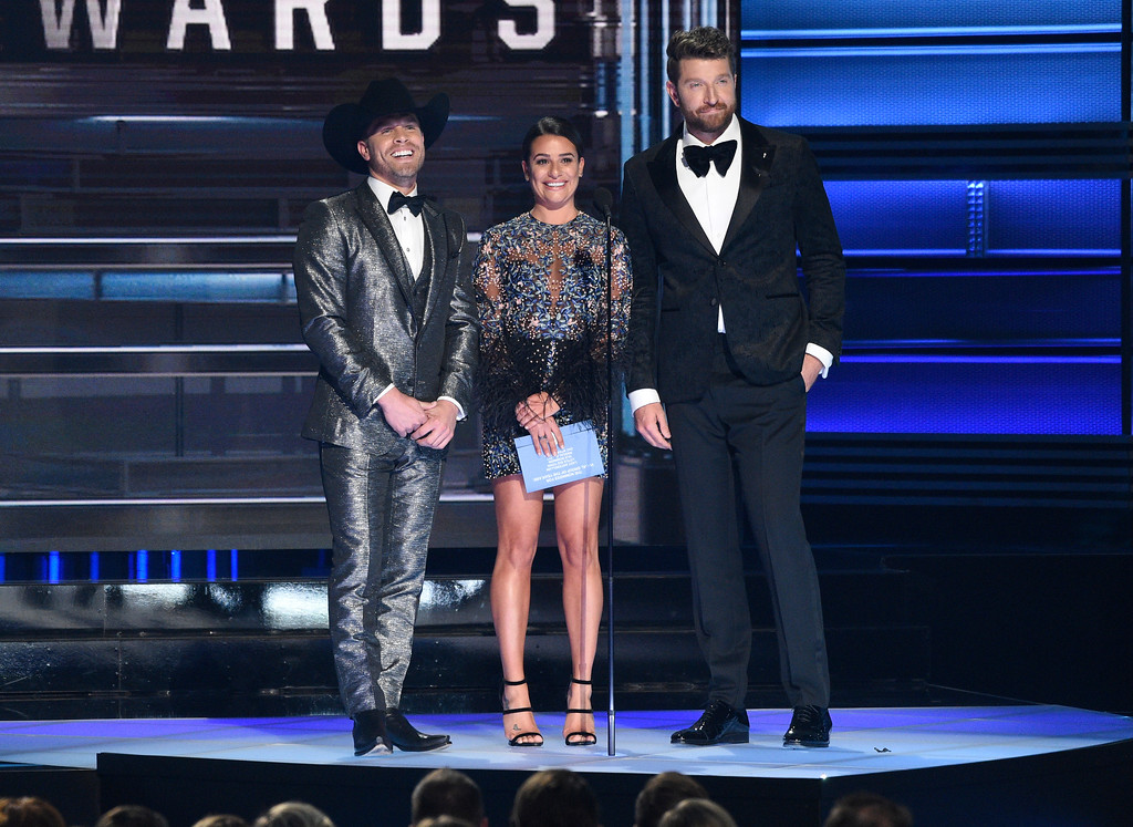 . Dustin Lynch, from left, Lea Michele, and Brett Eldredge present the award for vocal group of the year at the 51st annual CMA Awards at the Bridgestone Arena on Wednesday, Nov. 8, 2017, in Nashville, Tenn. (Photo by Chris Pizzello/Invision/AP)