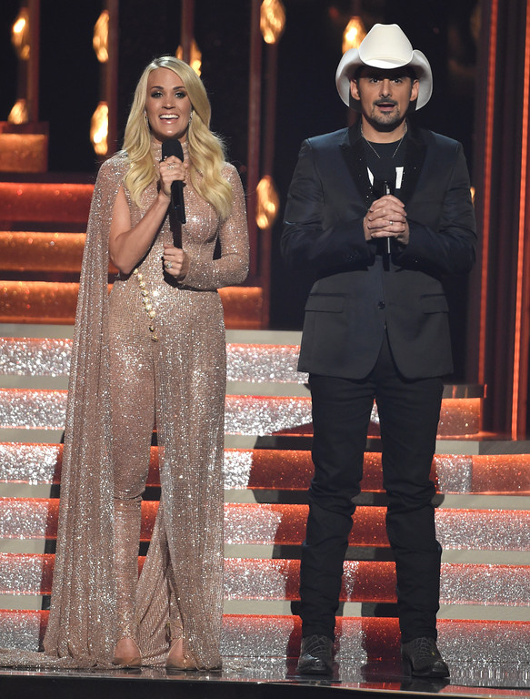 . Hosts Carrie Underwood, left, and Brad Paisley speak at the 51st annual CMA Awards at the Bridgestone Arena on Wednesday, Nov. 8, 2017, in Nashville, Tenn. (Photo by Chris Pizzello/Invision/AP)