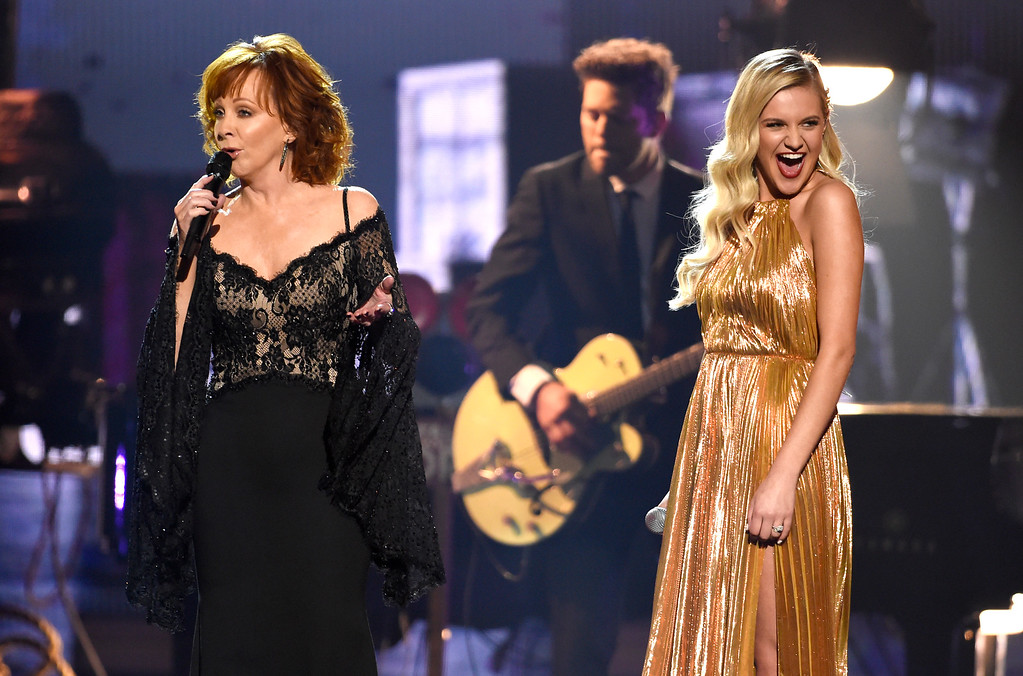". Reba McEntire, left, and Kelsea Ballerini perform ""Legends\"" at the 51st annual CMA Awards at the Bridgestone Arena on Wednesday, Nov. 8, 2017, in Nashville, Tenn. (Photo by Chris Pizzello/Invision/AP)"