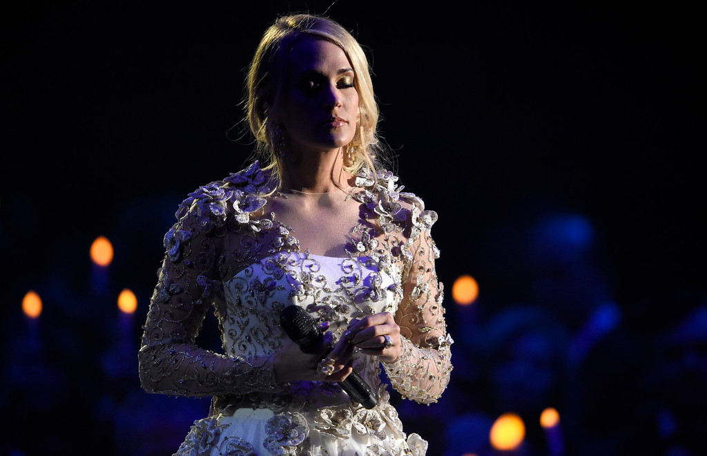 ". Carrie Underwood performs ""Softly and Tenderly\"" during an In Memoriam tribute at the 51st annual CMA Awards at the Bridgestone Arena on Wednesday, Nov. 8, 2017, in Nashville, Tenn. (Photo by Chris Pizzello/Invision/AP)"