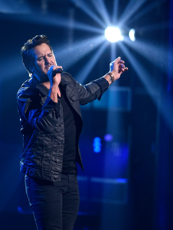 ". Luke Bryan performs ""Light It Up\""at the 51st annual CMA Awards at the Bridgestone Arena on Wednesday, Nov. 8, 2017, in Nashville, Tenn. (Photo by Chris Pizzello/Invision/AP)"