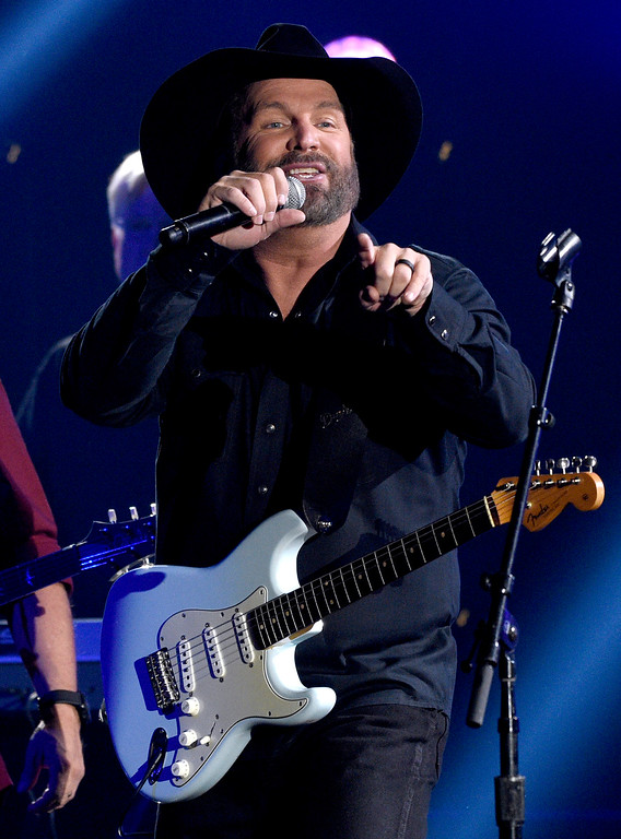 ". Garth Brooks performs ""Ask Me How I Know\"" at the 51st annual CMA Awards at the Bridgestone Arena on Wednesday, Nov. 8, 2017, in Nashville, Tenn. (Photo by Chris Pizzello/Invision/AP)"