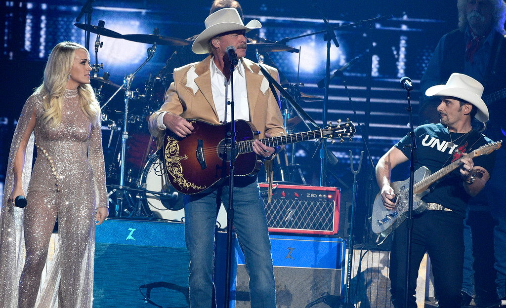 ". Carrie Underwood, from left, Alan Jackson and Brad Paisley perform ""Don\'t Rock the Jukebox\"" at the 51st annual CMA Awards at the Bridgestone Arena on Wednesday, Nov. 8, 2017, in Nashville, Tenn. (Photo by Chris Pizzello/Invision/AP)"