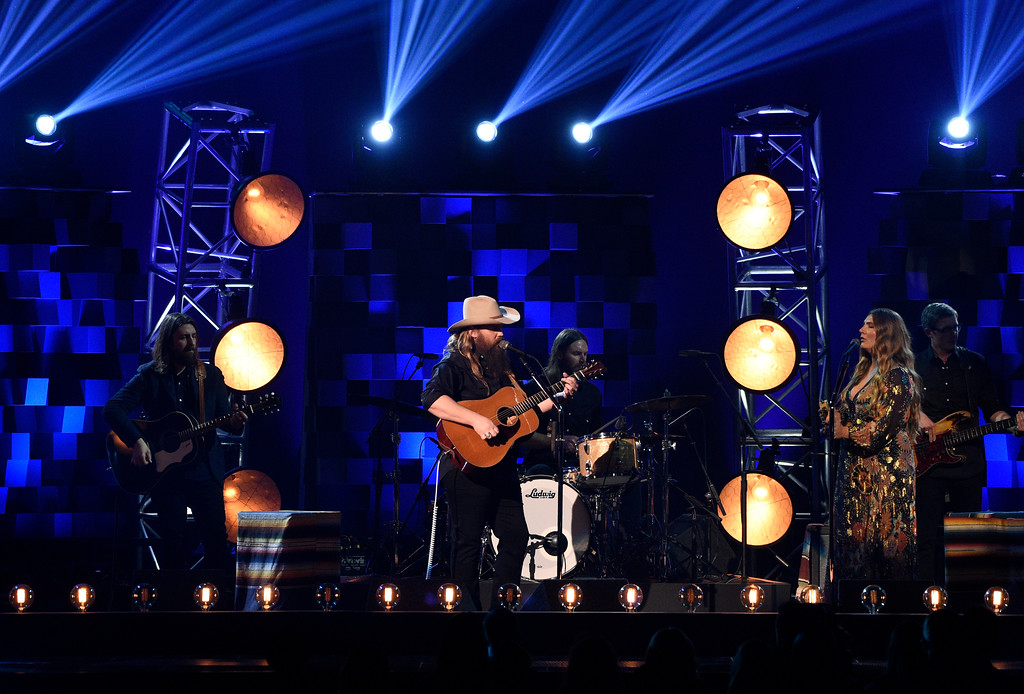 ". Chris Stapleton performs ""Broken Halos\"" at the 51st annual CMA Awards at the Bridgestone Arena on Wednesday, Nov. 8, 2017, in Nashville, Tenn. (Photo by Chris Pizzello/Invision/AP)"