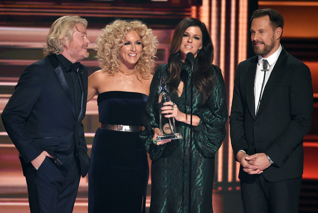 ". Philip Sweet, from left, Kimberly Schlapman, Karen Fairchild and Jimi Westbrook, of Little Big Town, accept the award for song of the year for ""Better Man,\"" on behalf of Taylor Swift, at the 51st annual CMA Awards at the Bridgestone Arena on Wednesday, Nov. 8, 2017, in Nashville, Tenn. (Photo by Chris Pizzello/Invision/AP)"