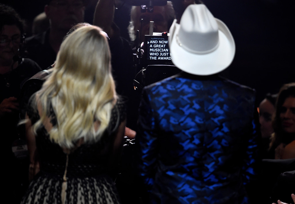 . Hosts Brad Paisley, right, and Carrie Underwood read a teleprompter during the 51st annual CMA Awards at the Bridgestone Arena on Wednesday, Nov. 8, 2017, in Nashville, Tenn. (Photo by Chris Pizzello/Invision/AP)