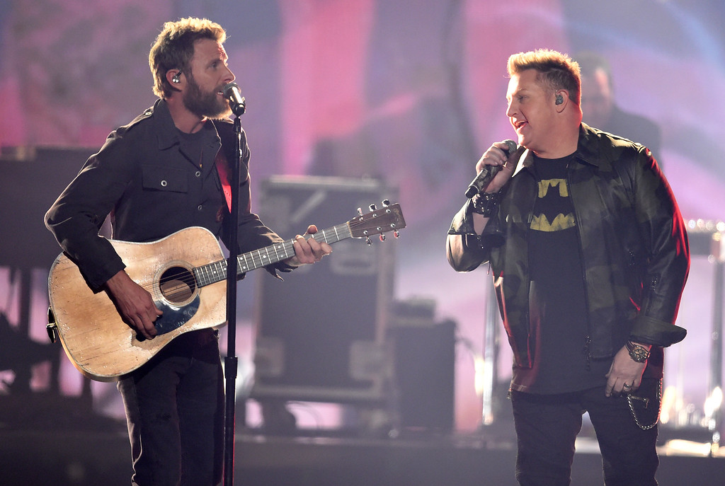 ". Dierks Bentley, left, and Gary LeVox, of Rascal Flatts, perform ""My Town\"" at the 51st annual CMA Awards at the Bridgestone Arena on Wednesday, Nov. 8, 2017, in Nashville, Tenn. (Photo by Chris Pizzello/Invision/AP)"