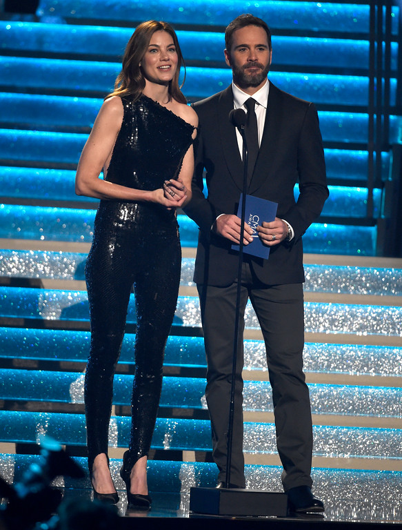 . Michelle Monaghan, left, and Jimmie Johnson present the the award for female vocalist of the year at the 51st annual CMA Awards at the Bridgestone Arena on Wednesday, Nov. 8, 2017, in Nashville, Tenn. (Photo by Chris Pizzello/Invision/AP)
