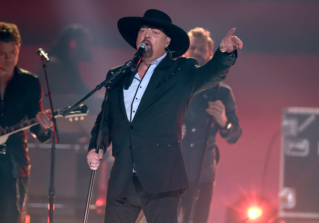". Eddie Montgomery performs ""My Town\"" at the 51st annual CMA Awards at the Bridgestone Arena on Wednesday, Nov. 8, 2017, in Nashville, Tenn. (Photo by Chris Pizzello/Invision/AP)"