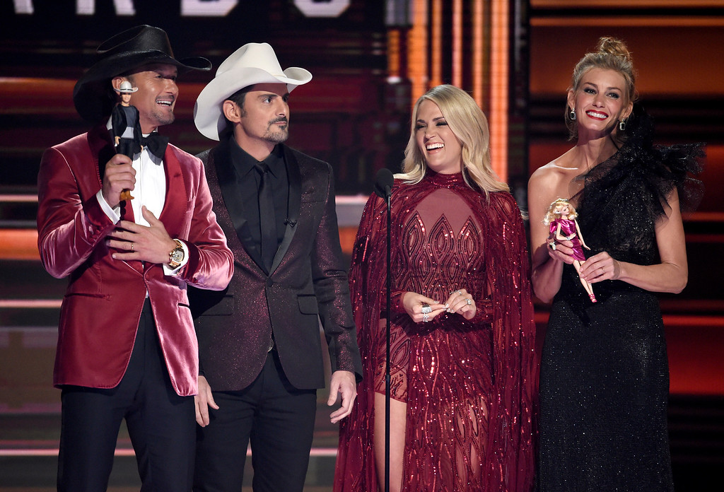 . Tim McGraw, from left, Brad Paisley, Carrie Underwood and Faith Hill speak at the 51st annual CMA Awards at the Bridgestone Arena on Wednesday, Nov. 8, 2017, in Nashville, Tenn. (Photo by Chris Pizzello/Invision/AP)