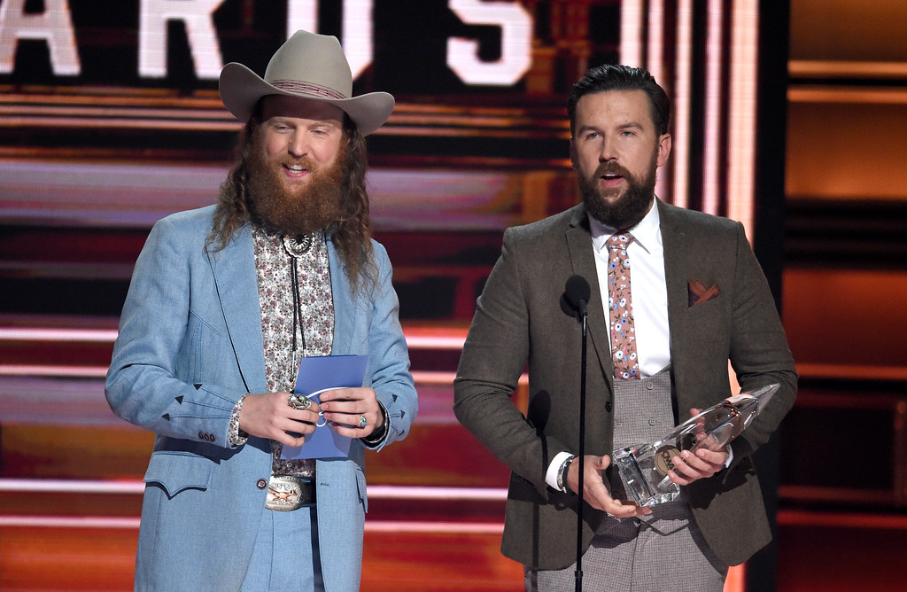 . John Osborne, left, and T.J. Osborne, of Brothers Osborne, accept the award for vocal duo of the year at the 51st annual CMA Awards at the Bridgestone Arena on Wednesday, Nov. 8, 2017, in Nashville, Tenn. (Photo by Chris Pizzello/Invision/AP)