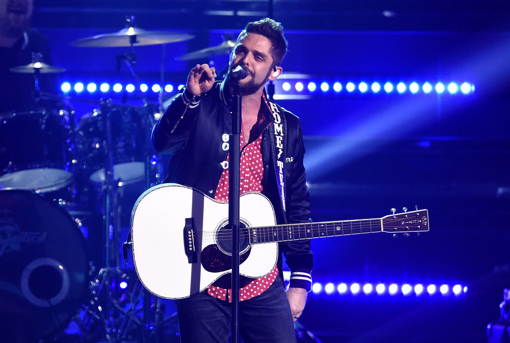 ". Thomas Rhett performs ""Unforgettable\"" at the 51st annual CMA Awards at the Bridgestone Arena on Wednesday, Nov. 8, 2017, in Nashville, Tenn. (Photo by Chris Pizzello/Invision/AP)"