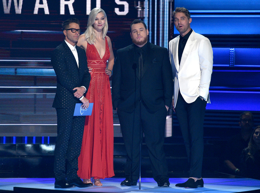 . Bobby Bones, from left, Karlie Kloss, Luke Combs and Brett Young present the award for song of the year at the 51st annual CMA Awards at the Bridgestone Arena on Wednesday, Nov. 8, 2017, in Nashville, Tenn. (Photo by Chris Pizzello/Invision/AP)
