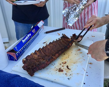 8/11.  Six racks of ribs cooked by Mitch Whatley and his son Conor.