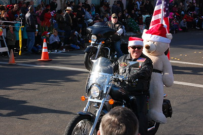 Over 300 entries lined up for this year's 53rd Holiday Parade. Smiling families wearing their finest — and fuzziest — Santa hats filled the sidewalks of Main Street, bundled under covers to watch the two-hour show.