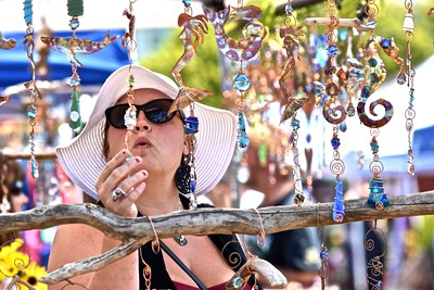 Alecia McClain looks at window decorations created by Ambrz Art of Arcata during the 57th annual Westhaven Wild Blackberry Festival Sunday. José Quezada—For the Times-Standard