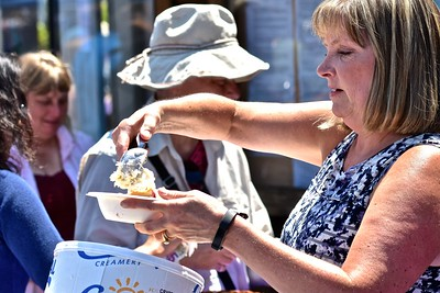 Erica Ervin  kept busy scooping up fresh vanilla ice cream to accompany hundreds of blackberry pie and cobbler bowls being served folks attending the festival. José Quezada—For the Times-Standard