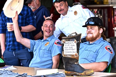 Westhaven Volunteer Fire Department Chief Shawn Worth clowns around with members of the department while soliciting support for fuel and equipment. José Quezada—For the Times-Standard