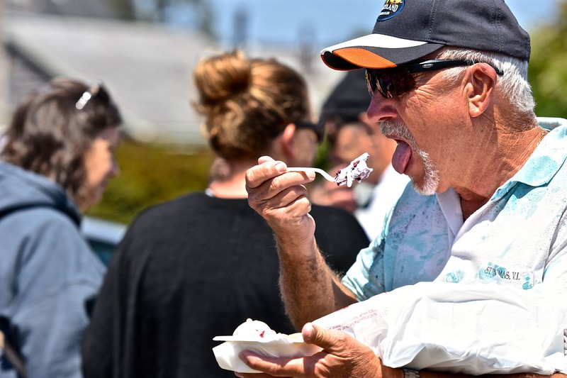 One of hundreds of visitors taking bites of the season's bountiful blackberries and vanilla ice cream. José Quezada—For the Times-Standard