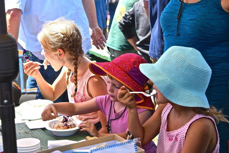 Maeve, 6, (middle) spoons out a bite of blackberry pie smothered in ice cream with her friends Emma McBurney and Lyla McBurney on Sunday at the Westhaven Wild Blackberry Festival. José Quezada—For the Times-Standard