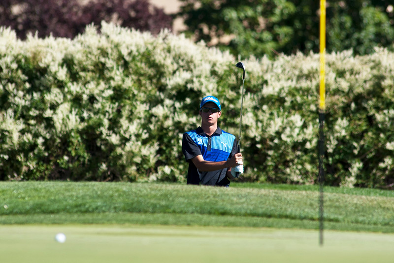 Photo by William Woody -- Kyle Pearson of Highlands Ranch pitches towards the par-three 17th green at Bookcliff Country Club Tuesday morning, Sept. 27, 2016, in Grand Junction Colo.