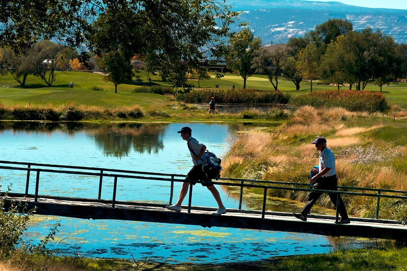 Photo by William Woody -- Freddie Gluck of Boulder, along with coach Rick Uhlir cross a bridge on the par-three 17th hole at Bookcliff Country Club Monday morning, Sept. 26, 2016, in Grand Junction Colo.