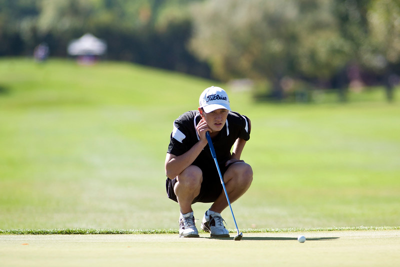 Photo by William Woody -- Andrew Perry of Fairview lines up a birdie putt on the par-four first hole at Bookcliff Country Club Monday morning, Sept. 26, 2016, in Grand Junction Colo.