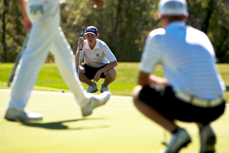 Photo by William Woody -- Freddie Gluck of Boulder lines up a birdie putt on the par-three 17th hole at Bookcliff Country Club Monday morning, Sept. 26, 2016, in Grand Junction Colo.