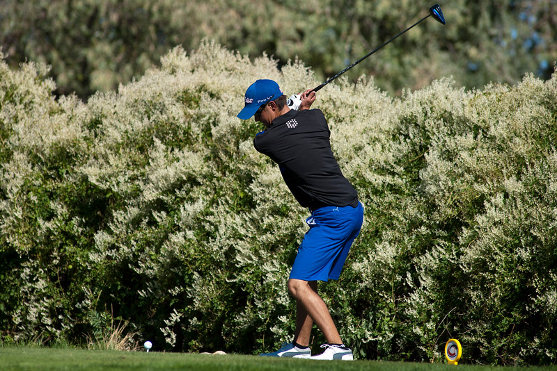 Photo by William Woody -- Kyle Pearson of Highlands Ranch, with a seven-shot lead, tees off on the par-five 18th hole to win the Colorado State 5A individual championship at Bookcliff Country Club Tuesday morning, Sept. 27, 2016, in Grand Junction Colo.