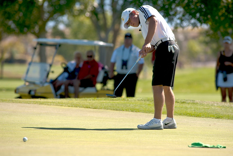 Photo by William Woody -- Nick Caldwell of Rock Canyon putts for birdie on the par-5 first hole at Bookcliff Country Club Tuesday morning, Sept. 27, 2016, in Grand Junction Colo.