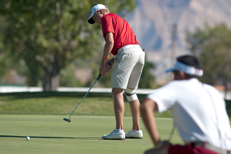 Photo by William Woody -- Daniel Pearson of Fairview putts for eagle on the par-five first hole at Bookcliff Country Club Tuesday morning, Sept. 27, 2016, in Grand Junction Colo.