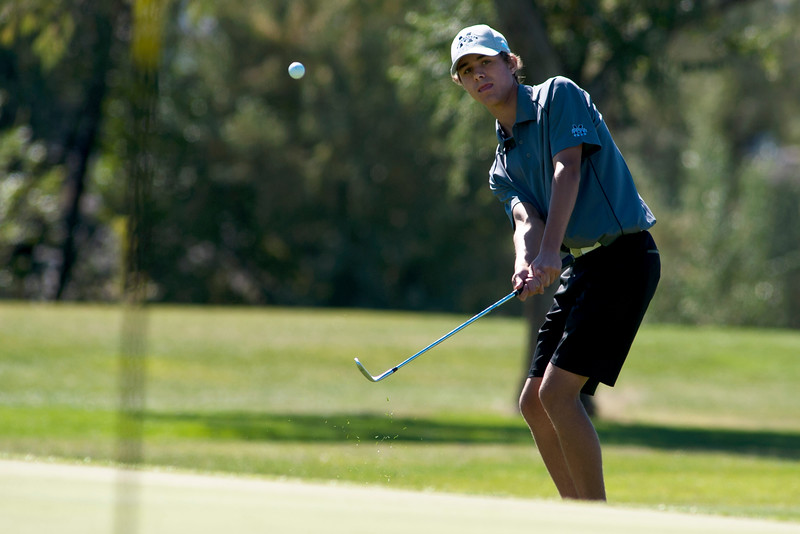 Photo by William Woody -- Danny Gallant of Monarch pitches towards the par-three 17th hole at Bookcliff Country Club Monday morning, Sept. 26, 2016, in Grand Junction Colo.