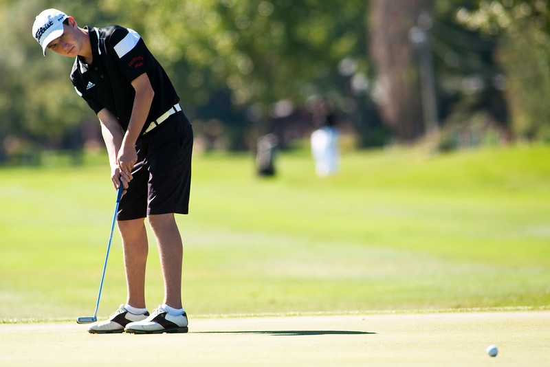 Photo by William Woody -- Andrew Perry of Fairview putts for birdie on the par-four first hole at Bookcliff Country Club Monday morning, Sept. 26, 2016, in Grand Junction Colo.