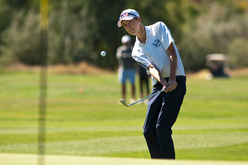 Photo by William Woody -- Shane Tilger pitches towards the 17th-hole at Bookcliff Country Club Monday morning, Sept. 26, 2016, in Grand Junction Colo.