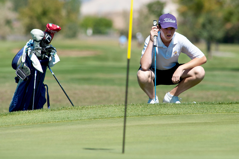 Photo by William Woody -- Freddie Gluck of Boulder prepares to putt from the rough on the par-four 16th-hole at Bookcliff Country Club Monday morning, Sept. 26, 2016, in Grand Junction Colo.