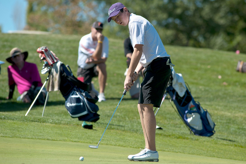 Photo by William Woody -- Freddie Gluck of Boulder putts for birdie on the par-five 18th hole at Bookcliff Country Club Monday morning, Sept. 26, 2016, in Grand Junction Colo.