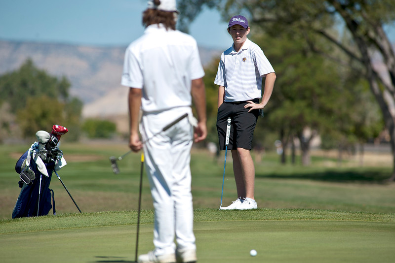 Photo by William Woody -- Freddie Gluck of Boulder putts from just off the par-four 16th-hole green at Bookcliff Country Club Monday morning, Sept. 26, 2016, in Grand Junction Colo.