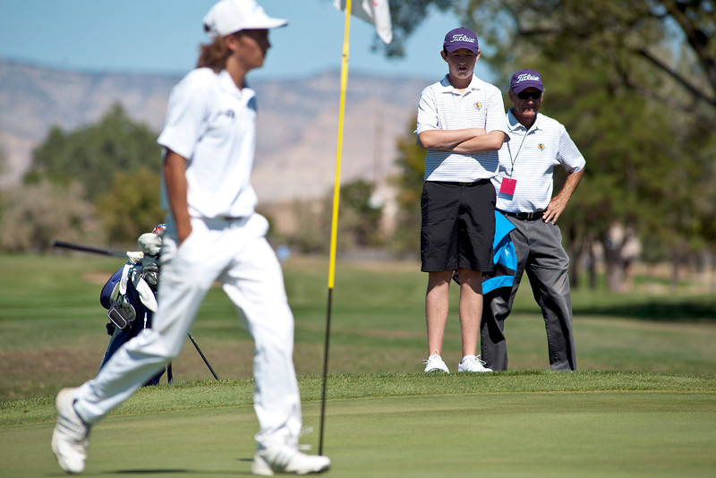 Photo by William Woody -- Freddie Gluck of Boulder and coach Rick Uhler examine Gluck's lie off of the 16th-hole green at Bookcliff Country Club Monday morning, Sept. 26, 2016, in Grand Junction Colo.