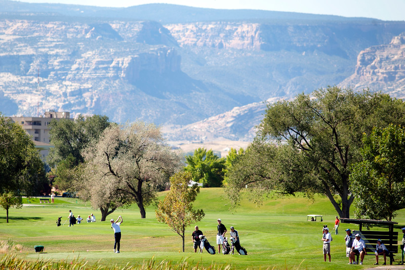 Photo by William Woody -- Shane Tilger tees off on the 17th-hole at Bookcliff Country Club under the view of the Colorado National Monument Monday morning, Sept. 26, 2016, in Grand Junction Colo.