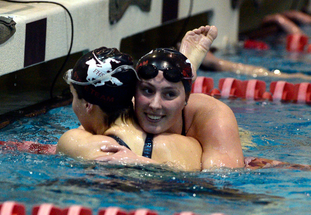 . THORNTON, CO FEBRUARY 9 2019 Fairview High\'s Amelia Lessing, facing camera, congratulates teammate Mya Drost-Parra after their swim in the 200 IM at the CHSAA Girls 5A State Swimming Championships at the Veterans Memorial Aquatics Center in Thornton on Saturday February 9, 2019. Drost-Parra finished 6th and Lessing finished 3rd.  More photos bocopreps.com. (Photo by Paul Aiken/Staff Photographer)