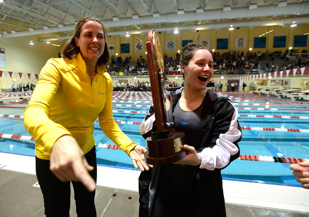 . THORNTON, CO FEBRUARY 9 2019 Fairview High\'s Mya Drost-Parra grabs the trophy after her team won the CHSAA Girls 5A State Swimming Championships at the Veterans Memorial Aquatics Center in Thornton on Saturday February 9, 2019. (Photo by Paul Aiken/Staff Photographer)