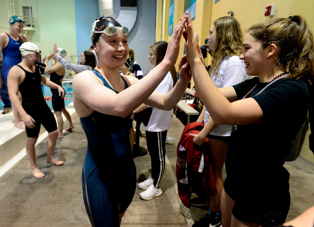 . THORNTON, CO FEBRUARY 9 2019 Fairview High\'s Morgan Simon gets a high five after her race at the Championships at the Veterans Memorial Aquatics Center in Thornton on Saturday February 9, 2019. (Photo by Paul Aiken/Staff Photographer)