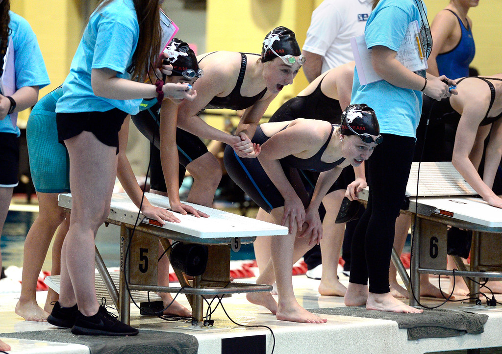 . THORNTON, CO FEBRUARY 9 2019 Fairview High\'s Emma Weber Jenna Reznicek and Riley Tapley cheer Morgan Lukinac who swam the final leg of the 200 meter relay at the CHSAA Girls 5A State Swimming Championships at the Veterans Memorial Aquatics Center in Thornton on Saturday February 9, 2019. Fairview won the event. More photos bocopreps.com. (Photo by Paul Aiken/Staff Photographer)