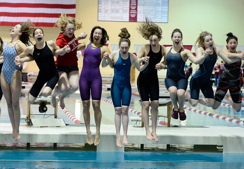 . THORNTON, CO FEBRUARY 9 2019 Fairview High\'s Swim Team does the traditional jump in the pool after winning the CHSAA Girls 5A State Swimming Championships at the Veterans Memorial Aquatics Center in Thornton on Saturday February 9, 2019. (Photo by Paul Aiken/Staff Photographer)