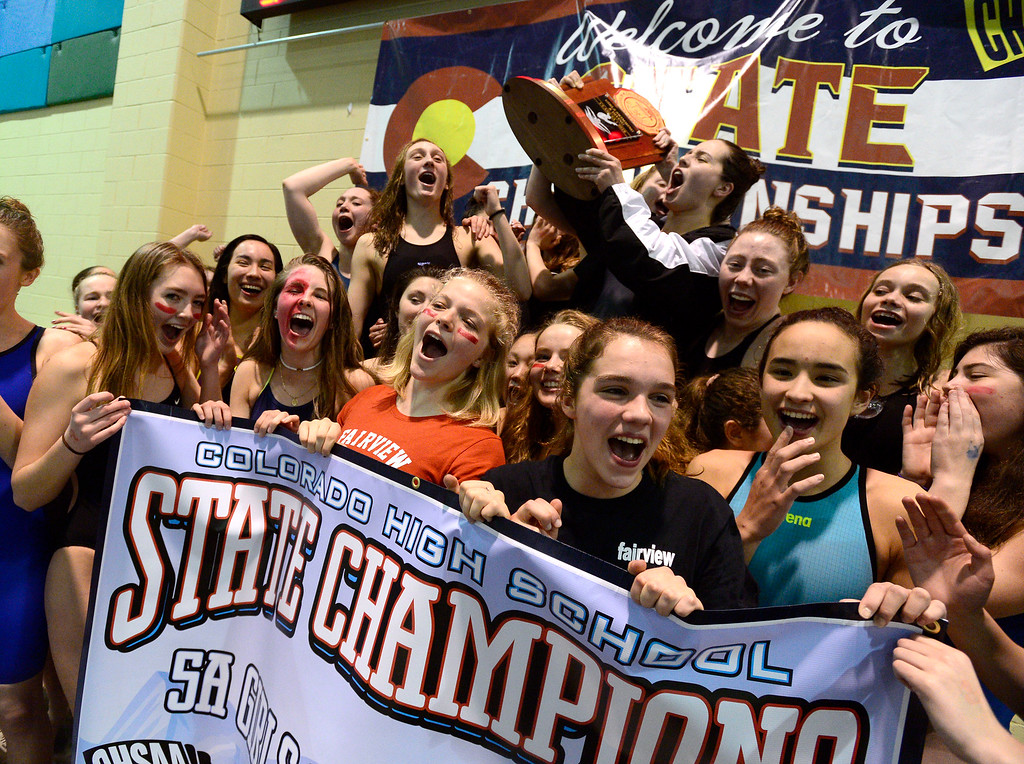 . THORNTON, CO FEBRUARY 9 2019 Fairview High\'s swim team celebrates with the trophy after winning the CHSAA Girls 5A State Swimming Championships at the Veterans Memorial Aquatics Center in Thornton on Saturday February 9, 2019. (Photo by Paul Aiken/Staff Photographer)