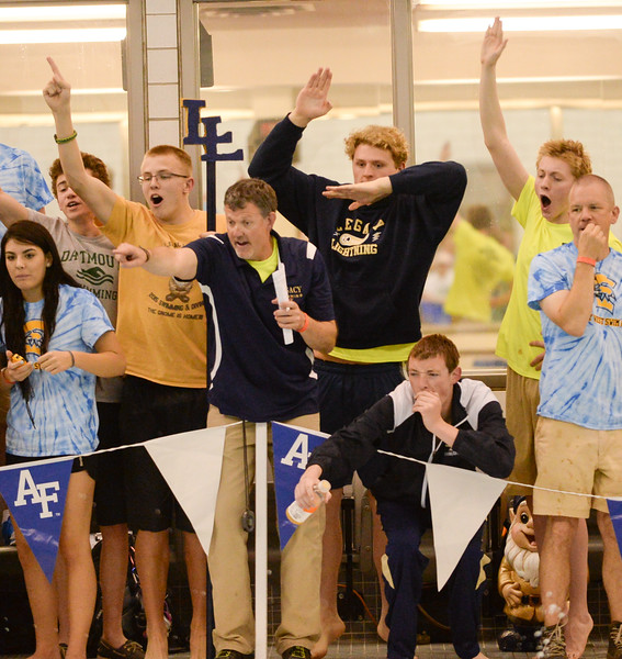 Legacy's coach and teammates cheering on Daniel Bradford during the 5A Boys State Swimming Championship on Saturday, May 21, 2016 at the Air Force Academy. Photo by Spotlight Sports Photography.