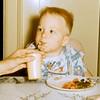 '56-Glenn sipping milk