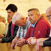 Men pray the Divine Mercy Chaplet. (Photo by Lance Murray / NTC)