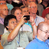 An attendee uses his phone to video Fr. Wade Menezes. (Photo by Lance Murray / NTC)